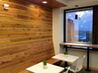 Reclaimed oak boards were used for wall cladding in the break room.