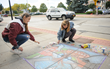 Ossining artists Zoe Supina and Melissa Twomey received first place at the Village's Chalk It Up! festival last year. Photo by: Michael Lee.