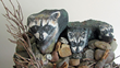 Connecticut Senior Juried Art Show: Honorable Mention in Sculpture Category – Vivian Newill, age 86, of Cheshire, CT – Raccoons (Rocks, Paint, Glue, Natural Materials)
