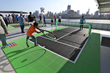 Youth play tennis on Sport Court ReImagine Tennis surface