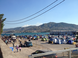 Migrants camped out in the Port of Mytilini, on the Greek island of Lesbos, which is receiving 2,000-3,000 new migrants each day. Photo by Jennifer Butte-Dahl/ShelterBox.