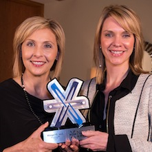 Virsys12 Founder & CEO Tammy Hawes accepting the 2013 NEXT award for Technology Start-Up, along with partner and Vice President of Consulting Services Valerie Landkammer.