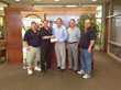 Badger Fire & Rescue accepting check from INS and partner WCCTA.