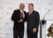 Sean Shahrokhi accepting award from Michael Gallagher at the awards ceremony in Chicago.