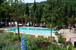 Antlers at Vail conference guests enjoy an outdoor buffet in the Vail hotel's scenic outdoor pool setting overlooking Gore Creek.