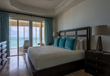 Tuscany master bedrooms with king beds overlook Grace Bay.
