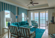 Living rooms with lovely furnishings overlook Grace Bay.