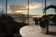 Screened in patios offer beautiful Grace Bay views at sunset.