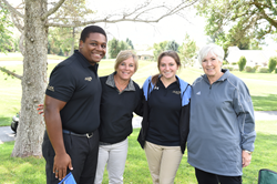 SLCC student Odassis Cheeks (l-r), SLCC President Deneece G. Huftalin, SLCC student Alyssa Wandell and Gail Miller on the Hidden Valley Country Club golf course.