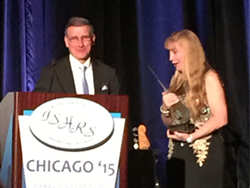 Miami hair surgeon Dr. Bernard Nusbaum accepts ISHRS 2015 Golden Follicle Award.