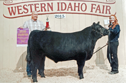 Annie Bass and grand champion steer