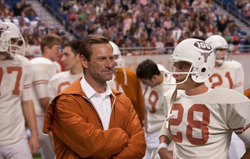 "Truly Moving Picture Award winner ""My All American"" stars Aaron Eckhart (left) as Coach Darrell Royal and Finn Wittrock as Freddie Steinmark."