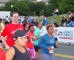 PenFed Credit Union employee Seth Longhurst makes 13.1 miles look easy as he smiles for the camera.