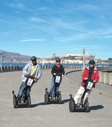 San Francisco Segway tour on the Maritime Pier with Alcatraz in the background.