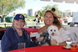 Adopt-A-Dog founder Donna Nives with Greenwich attendee Lis Suppo and her pups Alma and Bella at the 28th Annual Puttin' on the Dog
