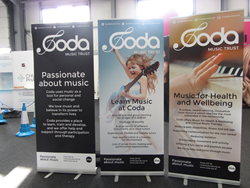 Coda Music receive a donation of new banners from Exhibition Stand designers, Quadrant2Design.