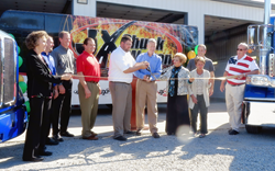 Indiana State Rep. Sheila Klinker (fourth from right), leads JX personnel in ceremonial ribbon cutting