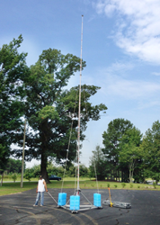 Technician demonstrates mobility of PLP-39-MOB portable lightning protection mast