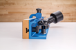 The side view of Rockler's new Drill Press Fence shows how the dust port is angled upward and off to the side, keeping dust collection components clear.
