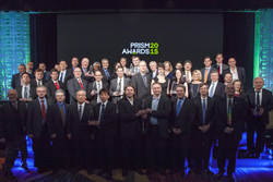 Winners, presenters, and judges celebrate after announcement of the 2015 Prism Awards for Photonics Innovation.
