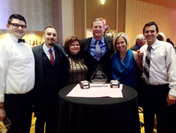 Crimson Cup team accepts the Corporate Partner Award from Cancer Support Community Central Ohio