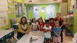 Mainspring Managing Director Mandy Brooks (left) with a group of kids from Mainspring and Kitchen Manager Stephanie Wells