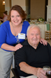 Amanda Annis, resident services director, Allerton House at Central Park in Weymouth greets resident Rocky DiFazio at the annual Assisted Living Week Luncheon.