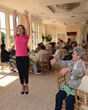 Guest speaker Lauretta Jennings, a certified personal trainer and Chaboom instructor delighted guests with a spirited demonstration of some of the exercises she teaches the assisted living residents.