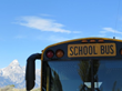 Grand Teton visible behind school bus parked at Kelly Elementary School, bordering on National Park and recently remodeled by Ward + Blake Architects of Jackson, Wyo.