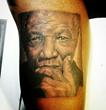 Black and Gray Nelson Mandela Photo Realism Tattoo