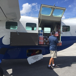 Tropic Ocean Airways Captain Loading Aircraft for Hurricane Joaquin Support