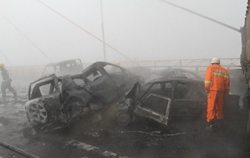 Scene of a fog-related nine car pile up which resulted in one death and multiple injuries.