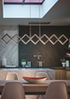 LBL Lighting's Xterna linear suspension is shown here, fully open, in a kitchen