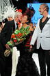 HH Prince Waldemar Schaumburg-Lippe presents Sue Wong with flowers. Photo by Derrick Rogers