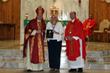 Kathy Post with Bishop Barbarito and Father Thomas Barrett