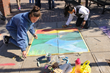 Ossining High School student artists Mae Jiminez and Jen Mielke tied for third place at the Village of Ossining's second annual Chalk It Up! festival held recently at Market Square. Photo by: Michael