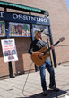 Singer/musician Adam Love performs at the Village of Ossining's second annual Chalk It Up! festival held recently at Market Square. Photo by: Michael Lee.