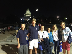 Rosarian-Academy-students:-(L-R)-Peter-Fields,-Liam-Groth,-Hailey-Albergo,-Mariana-Perez-Vargas,-Charlotte-Breckenridge,-and-Robert-Fox-stand-in-front-of-the-Capitol