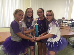 Rosarian-Academy-Purple-Team-Members:-(L-R)-Lauren-Bartl,-Lily-Cook,-Frances-Melendez,-Daisy-Cook-with-Field-Day-trophy