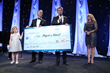 Augie's Quest Tradition of Hope gala honoree, Bert Selva, went up on stage with David Foster and Jann Carl for the night's check presentation. Photo credit Steve Cohn.