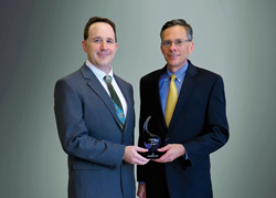 Rich Yezzi and Mark Muskevitsch of JX shown with the Deloitte 75 Award