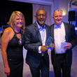 Skillbridge CTO & Co-Founder, Saalim Chowdhury with the Bully Award and White Bull Summit Chairs Elizabeth Perry and Farley Duvall