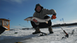 Local guide Florent Hebert shows off his catch at Manoir Hovey, where guests can enjoy winter ice fishing lessons on the frozen lake.