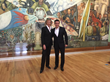 Summit co-chairs Gina Diez Barroso and Alfredo Carvajal in front of mural at Palacio de Bellas Artes, site of Summit gala event