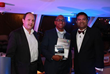 "Roger Gregory (center), VP Product Marketing Greenwave Systems,   receives the award ""Most Innovative IoT Solution"""