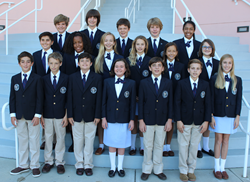 Rosarian-Academy-seventh-grade-students-who-qualified-as-Duke-TIP-Scholars-standing-in-uniform-on-stairs