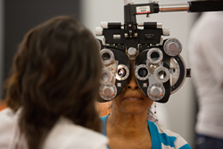 Picture of a Care Harbor patient receiving a free vision screening