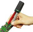 Hand using LED Test Tweezers