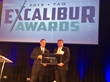 Nathan Burnham, JCB North America IT Director, accepts the TAG Excalibur Award from Tino Mantella, President & CEO of TAG.