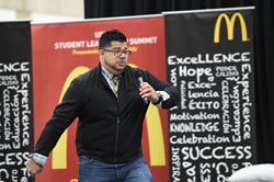 Motivational speaker Carlos Ojeda, Jr. tells area Hispanic high school students about his life during a USHLI summit at Salt Lake Community College.